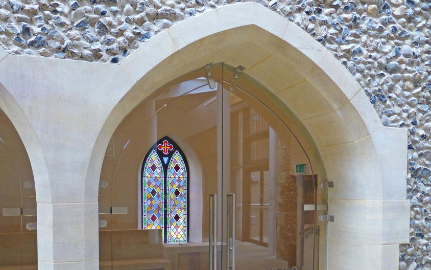 Clipsham stone arched door