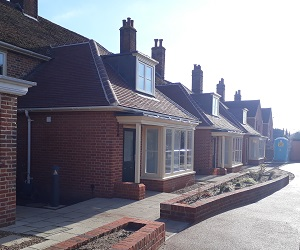 Refurbishment and extensions to nine almshouses,